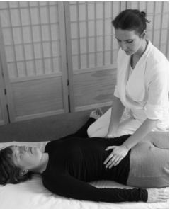 photo of Shiatsu treatment on abdomen with Maria Shlumukova for Edinburgh Shiatsu