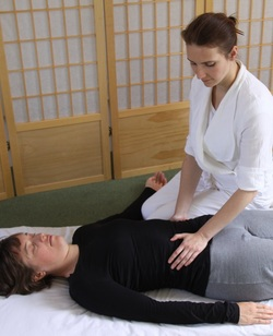 Maria Shlumukova - Shiatsu treatment on abdomen at Meadowlark Healthy for Sport, Edinburgh